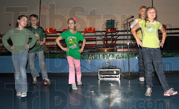 Heel and toe: Hoosier Prarie Elementary School third graders Cassidy Hunt, Noah Boise, Addi Hodges, Danielle Voges and Madison Rice dance a jig as part of Cathy Laskas presentation on her visit to Ireland recently.