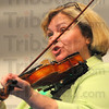 From Ireland: Cathy Laska plays her violin with The Women of Erin and Carl Friday afternoon at Hoosier Prarie Elementary School.