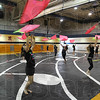 Flying high: Caden Smith and the rest of the Terre Haute North Color Guard practice in the school's auxiliary gym Friday evening.