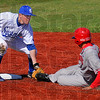 In time: Indiana State shortstop Ben Ferrell puts the tag on Redbird baserunner Jake Thornton as he tries to steal second base.