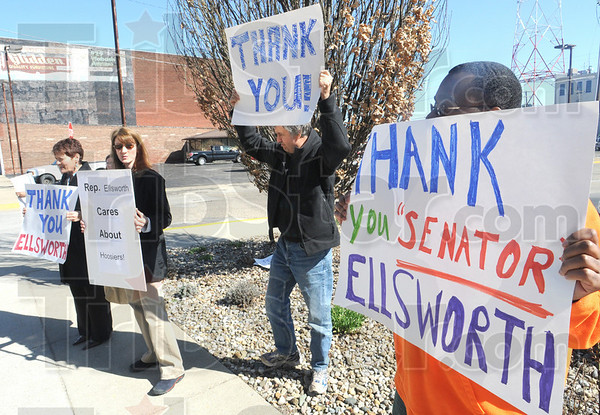 Supporters: A small group of people display signs in front of Brad Ellsworth's Terre Haute office Friday afternoon in support of his vote for health care passage.