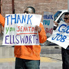 "Thumbs up: Aaron Calbert gives a passing motorist the old ""thumbs up"" as one of seven people that rallied to thank Brad Ellsworth for voting for the health care bill."