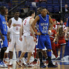 The Redbirds begin to pull away: Indiana State's Dwayne Lathan (20) reacts to a foul called on teammate Carl Richard, left, during the team's loss to Illinois State Friday at the Missouri Valley Conference Tournament in St. Louis.