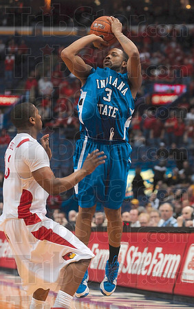 Photo by Joseph C. Garza/Tribune-Star<br /> Trying to make a game of it: Indiana State's Rashad Reed unleashes a three-point shot over an Illinois State opponent in the final minutes of the Sycamores' loss Friday in the MVC Tournament in St. Louis.