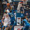 Tribune-Star/Joseph C. Garza<br /> Denied in the paint: Indiana State's Isiah Martin blocks Illinois State's Jackie Carmichael as teammate Koang Doluony looks on during the Sycamores' loss to the Redbirds in the MVC Tournament in St. Louis.