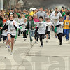 Stampede: Runners of all types leave the starting line Saturday morning during the annual Irish Dash.