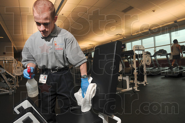 Tribune-Star/Joseph C. Garza<br /> Keeping it clean: Terre Haute North student, Mike Carlson, 22, cleans a piece of equipment in the Union Hospital Center for Fitness and Performance Friday through the Project SEARCH Program.