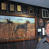 Dog lover: Steve Harrold proudly displays his dog related artwork and trophies in his southside business.
