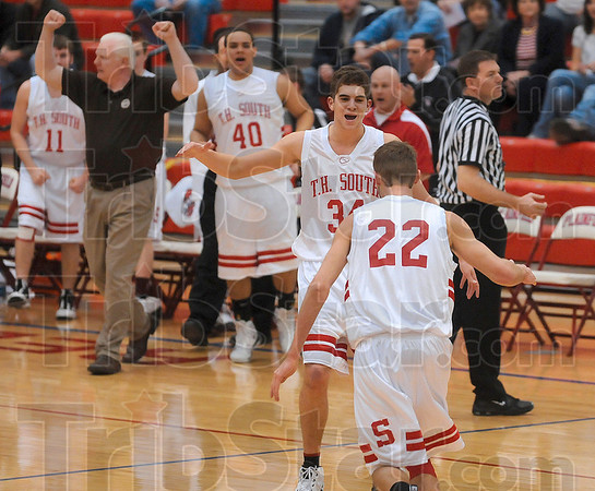 What a performance!: Terre Haute South's Jacob Tanoos congratulates teammate John Michael Jarvis on a great performance that included three-point shots and steals in the first half of the Braves' sectional championship game against Martinsville Saturday at Plainfield High School.