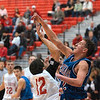 Tribune-Star/Joseph C. Garza<br /> No easy shots: Terre Haute South's Anthony McGill is blocked by Martinsville's Derek Johnson during the teams' sectional championship game at Plainfield High School Saturday.