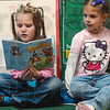 "Tribune-Star/Joseph C. Garza<br /> Hello reading: Terre Town Elementary first grader Miranda Flowers reads ""Baa-Choo!"" to fellow first grader Jaelynn Pizzola during an after school reading program at the Terre Town Wednesday."