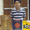Champion: Honey Creek student Abin Karki poses with the prizes he won Saturday as champion of the annual spelling bee.