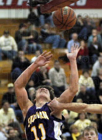 Not: Sullivan's #11, James Lisman is grabbed as he attempts a shot during sesctional action against South Vermillion Wednesday evening.