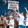 "Tribune-Star file photo/Joseph C. Garza<br /> MVC Champs: Indiana State's Terence Avery (right) points to the word ""Champs"" on a sign after the presentation of the MVC Tournament trophy to the Sycamores Monday, March 5, 2001 in St. Louis."