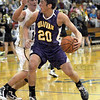 Looking: Sullivan's #20, Rhett Smith looks for an open teammate during sectional action at Owen Valley