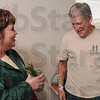 """Tribune-Star/Joseph C. Garza<br /> A little something for you: Regional Hospital cancer patient Robert Maynard receives a """"Gift of Hope"""" from American Cancer Society's Dawn Clinkenbeard Monday at Regional Hospital."""