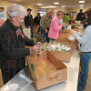Tribune-Star/Joseph C. Garza<br /> Right off the truck from Seattle: Volunteer Jean Freed helps package daffodils taken off a truck from Seattle for the American Cancer Society's Daffodil Days Monday at the Wabash Valley Fairgrounds. Volunteers were on hand to help with the organization's annual fundraiser by wrapping the flowers and then delivering them to businesses.
