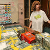 Tribune-Star/Joseph C. Garza<br /> More razors, over here: Sarah Scott Middle School eighth-grader Jamie Shoup calls for more razor packs as he packs boxes for the Little Pieces of Home program Monday at the school.