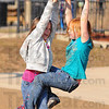 Hanging around: Friends Katie Williams and Danielle Norris twist and spin together at the Deming Park playground Monday afternoon.
