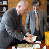 Gift exchange: Rose-Hulman President Matt Branam opens a gift from Shigeaki Tsunoyama, president of Japan's University of Aizu Tuesday morning.