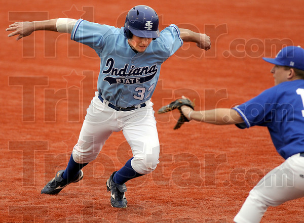 Swan dive: Indiana State's #32, Kevin Austin dive back to first base during action against Eastern Ill. Tuesday afternoon.
