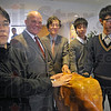 "Touch for luck: Rose-Hulman President Matt Branam, Aizu University President Shigeaki Tsunoyama and Aizu students Tomoya Sakai (L) Yusuke Abe (second from R) andMasaki Okano touch the Rose-Hulman mascot ""Rosie"" for good luck Tuesday morning."
