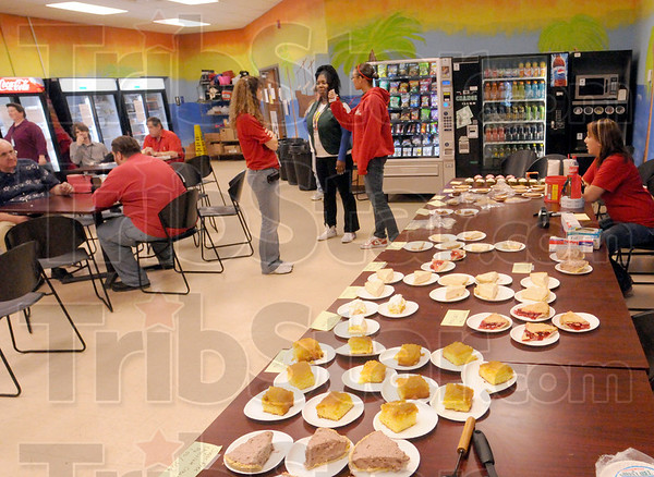 Fundraiser: A wide variety of pies and cakes line the table of the Alocica break room Tuesday afternoon.
