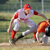 Gotcha...not: Marshal's #47, third baseman Ryan Hefner attempts to put a tag on Paris runner #7, Ethan Mason during Tuesday's game. Unfortunately the ball isn't in his glove and squirts away from the play (left).