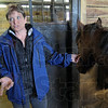Equine: Sara Schulz talks with Tribune-Star reporter Arthur Foulkes from the stall containing one of four mustangs they received partnering with the Bureau of Land  Management.