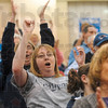 Tribune-Star/Joseph C. Garza<br /> She belongs to No. 50: Julie Gant, the mother of Terre Haute North Center Justin Gant cheers with other fans as the Patriots wrap up their sectional win against Plainfield Tuesday at Plainfield High School.