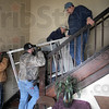 Stairway to Heaven: Construction workers Adam Muller, John Montgomery, Terry Lewis and Tony Major muscle a heavy piece of a chair lift up the stairs of the historic Allen Chapel Tuesday afternoon.