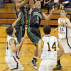 Mine: West Vigo's #5, Tyler Wampler snatches a a rebound in a crowd of Brown Co. defenders durng second half action Tuesday night at Owen Valley.