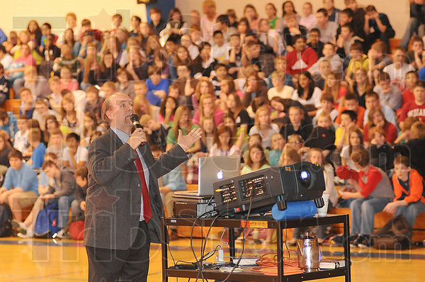 Twain fan: Michael Shelden presents a slide show for the students at Honey Creek Middle School Tuesday afternoon. Shelden, who teaches at Indiana State University. recently rinished a book on Mark Twain.