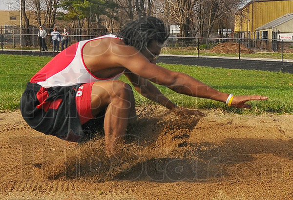 Leaper: Chris Rose lands at 17 feet 5 inches on his first atempt in the long jump Tuesday evening. The Terre Haute South track teams hosted the boys and girls from West Vigo in a dual meet.