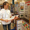 Reading and writing: Honey Creek Middle School 6th grader Anne Hubbard looks through the writings of her classmate Hannah Weber from her display in the foyer of the school.