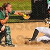 Stop ahead: West Vigo catcher Leah Ross prepares for the collision with Mustang baserunner Rayne Salyers. Salyers was safe stealing home.