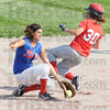 Beat it: South's #30, Taylor Derickson makes it past Linton shortstop #11, Sam Butt during game action Thursday evening.