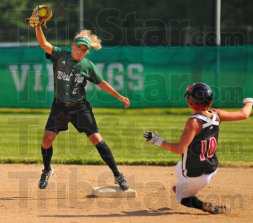 Too late: West Vigo Secondbaseman Sam Richey grabs the throw, but can't stop Edgewood baserunner Laura Luther from stealing second base.