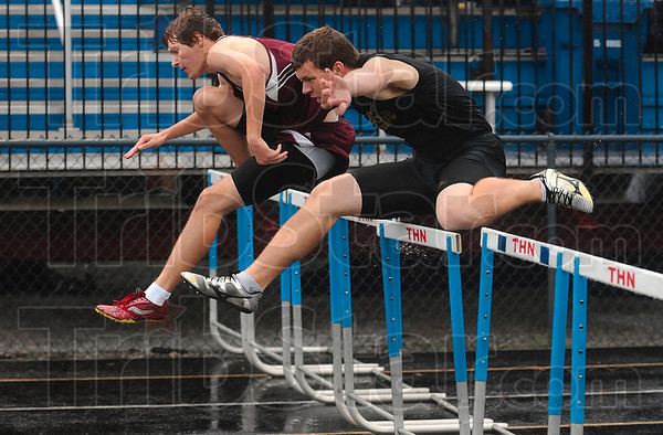 Neck and neck: Northview's Joel Whittington and South Vermillion's Jordan Cottrell clear the second to last set of hurdles as they lead all other competitors in the 110-meter hurdles of the boys track sectional Friday at Terre Haute North. Whittington won the race.
