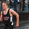 The closest thing behind him were the raindrops: Terre Haute South's Stewart Dagnon kicks up the rain as he cruises to a first place finish in the 400-meter dash of the boys track sectional Thursday at North.