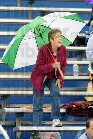 Rootin' in the rain: Audrey Fritz cheers for Clay City hurdler Ethan Shaw as he competes in the sectional track meet at Terre Haute North Thursday evening.