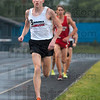 Staying in the lead: Terre Haute North's John Mascari leads the pack during the 3200-meter run of the boys track sectional Thursday at Terre Haute North. Mascari won the event.