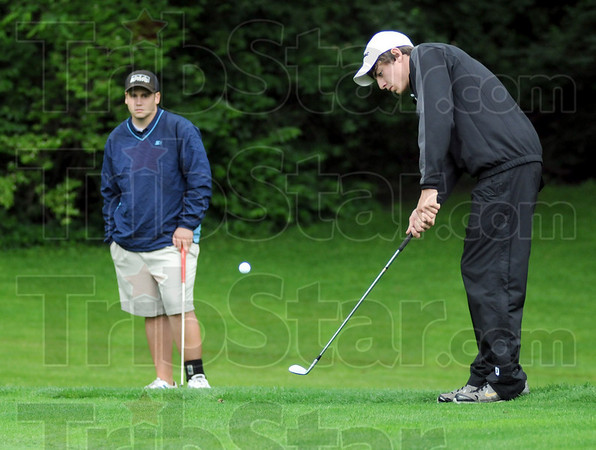 Match action: North's Nick Vrabic (L) watches as South Vermillion's #1 player Brandon Bekkering hits a chip shot to the second green at Hulman Links Thursday afternoon.