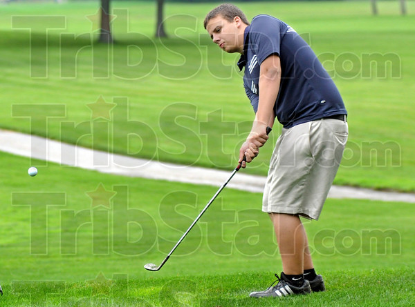 To the green: North's Michael Rose hits a shot onto the first green at Hulman Links during match action against South Vermillion Thursday evening.