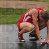 Reigning in the rain: Terre Haute South's Taylor Head rests on the track after he and his teammates finished first to take the 4x800-meter relay Saturday during the track sectional at Terre Haute North.