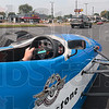 Yes, that is an IndyCar in your rearview mirror: Izod IndyCar Series Tour car driver Grant Richey takes off through traffic as he travels on Fort Harrison Road Thursday with Tribune-Star photographer Joseph Garza in the back seat of the racecar.