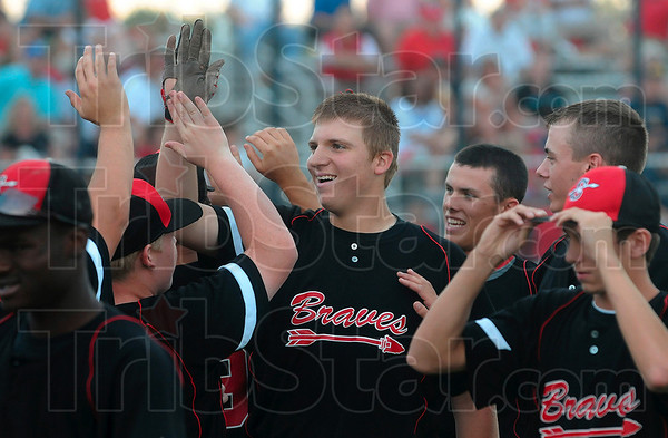 Over the fence: Terre Haute South's A.J. Reed, center, is congratulated by his teammates after he hit a homerun against Martinsville Thursday at the Terre Haute North baseball sectional.