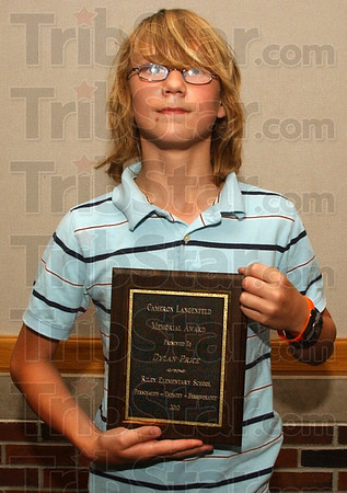 Award winner: Riley Elementary School 5th grader Dylan Price was awarded the Cam Langenfeld Memorial Award Thursday evening.