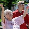 Praise: Terre Haute resident Julie Morgan sing praise during Thursday's National Day of Prayer event at Terre Haute City Hall.