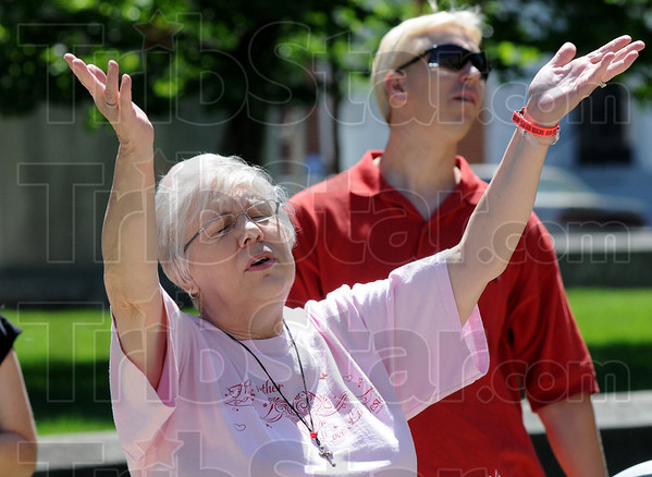 Praise: Terre Haute resident Julie Morgan sing praise during Thursday's National Day of Prayer event at Terre Haute City Hall.